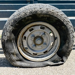 Flat tire Trailer repair, Worn flat trailer tire picture
